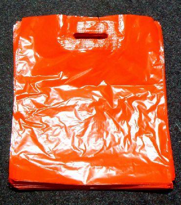 LDPE taška průhmatem, červená, velikost: 380x440mm.